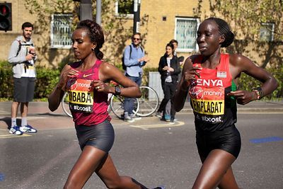 Tirunesh Dibaba (3rd) of Ethiopia and Edna Kiplagat (1st) of Kenya Running in the  Elite Womens Event at the 2014 Virgin London Marathon