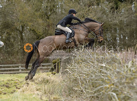 Alice Robb jumping a hedge at Orton Park