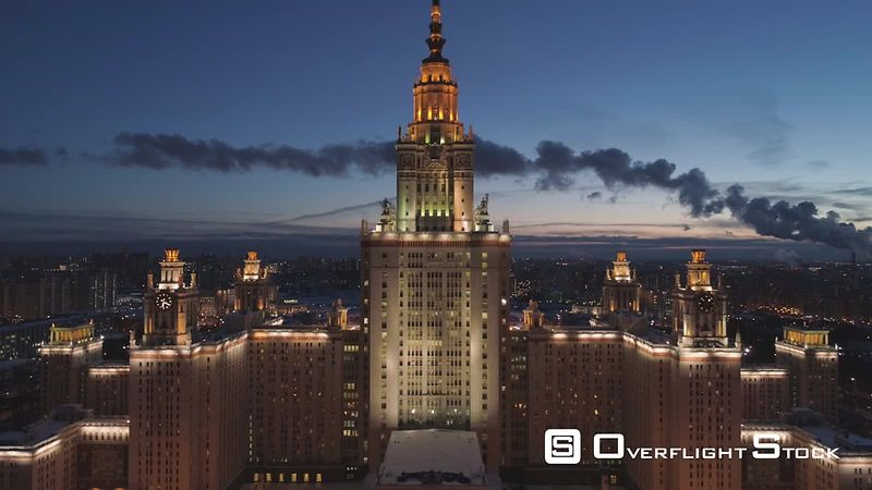 Moscow State University Main Campus and Illuminated Moscow Cityscape at Winter Twilight. Russia. Aerial View. Drone is Flying Upward. Establishing Shot.