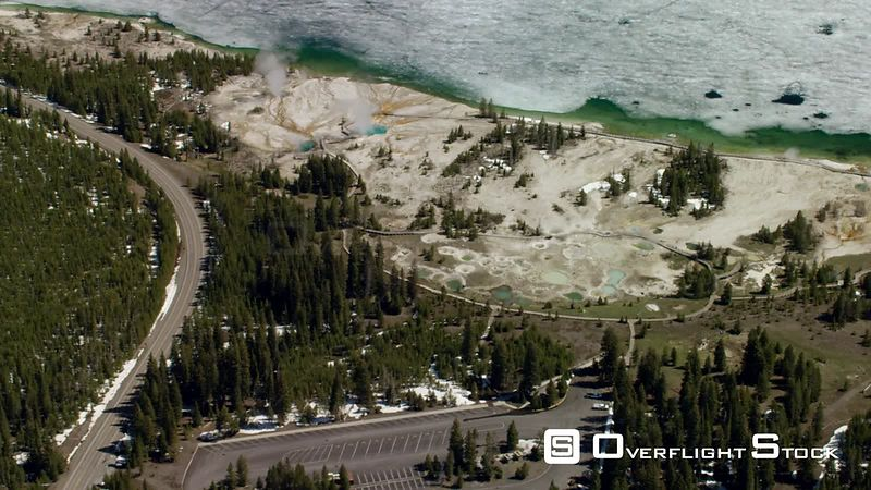 The West Thumb Geyser Basin features dramatic, colorful geothermal features, and sits next to a frozen Yellowstone Lake, in Yellowstone National Park