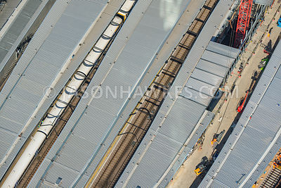Aerial view of London, close up of trains in platforms at London Bridge Station.