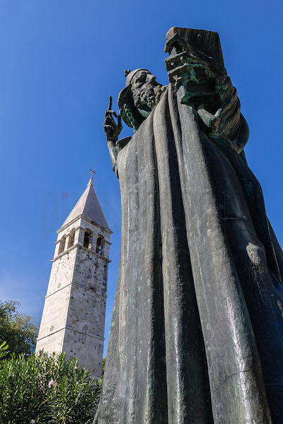 Father of Croatian Literacy, Grgur Ninski statue by Ivan Meštrović, with a tower of the Diocletian's Palace in the background