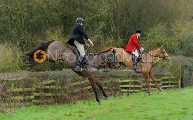 Ashley Bealby jumping a hedge from Town Park Farm