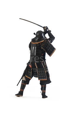 A silouette of a Samurai warrior with his sword in the air - shot from mid-level.