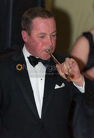 Belvoir Huntsman John Holliday blowing a hunting horn