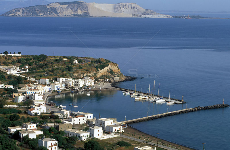 Yachts lined up at the harbour on the island of Nyssiros, Dodecanese Islands, Greece