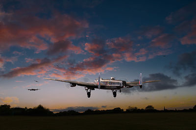 Lancasters taking off at sunset