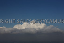 Clouds and blue sky aerial photograph of a Cumulus clouds set against a deep blue sky