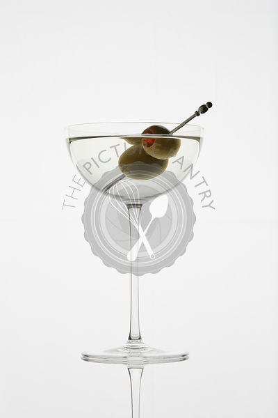 Classic Martini Cocktail photographed backlit on white background