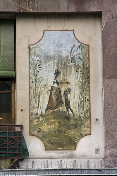 France - Paris - Architectural details of murals on the walls above the shops in the Rue Mouffetard.