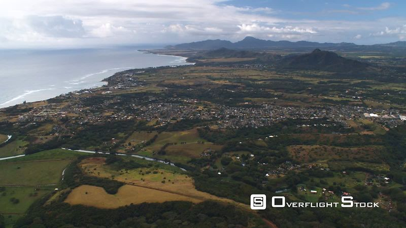 High view of coastline at Kapaa with Wailua River in foreground, Hawaii.
