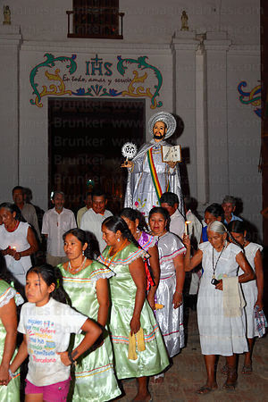 Abadesas accompany figure of San Ignacio from church to Mojeño Cabildo (parliament) building at start of festival, San Ignacio de Moxos, Bolivia