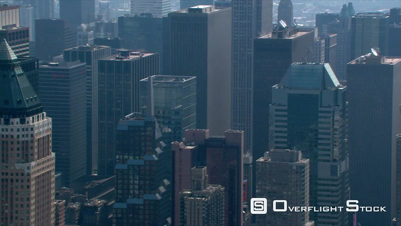 Steep aerial view of Manhattan skyscrapers.