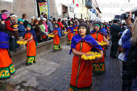 Women throw flowers in the path of the Inca during processions for Inti Raymi festival , Cusco , Peru