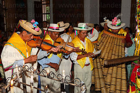 Musicians playing Bajon Mediano during mass, San Ignacio de Moxos, Bolivia