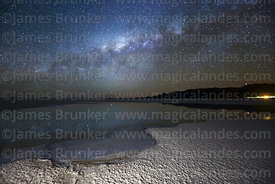 Milky Way Galactic Centre above saline pool, Salar de Uyuni, Bolivia