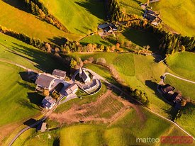 Overhead view of church in autumn, Dolomites, Italy