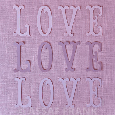 Word Love on coloured background
