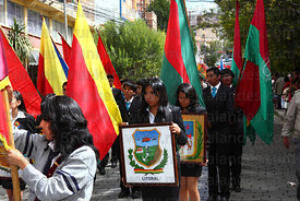 College girl holding badge of Bolivia's former Litoral Department during parades for Dia del Mar / Day of the Sea , La Paz , Bolivia