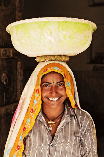 Female Laborer Carrying Load on Head