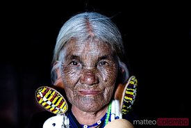 Portrait of old woman with tattoed face, Chin state, Myanmar