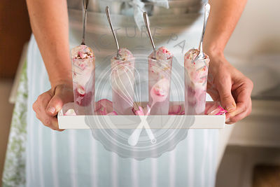 raspberry ripple ice cream in shot glasses held in hands on tray