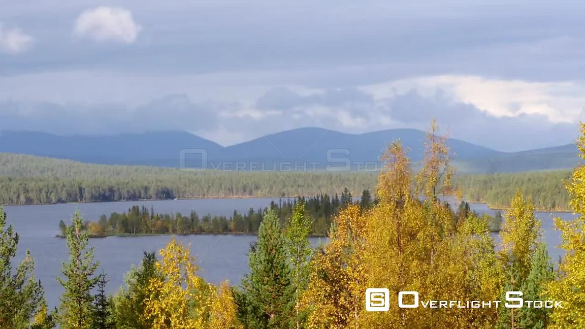 Autumn Color Landscape, Zoom Out Time Lapse of Autumn Trees, a Lake and Fjeld Tunturi Mountains, on a Sunny and Rainy Fall Day, in Sarkijarvi, Near Pallasyllas National Park, Lapland, Finland