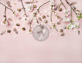 Easter background with eggs, almond flowers and feathers