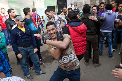 Egypt - Cairo - Boys and youth dance to a sound system in the streets to celebrate a wedding, Islamic Cairo