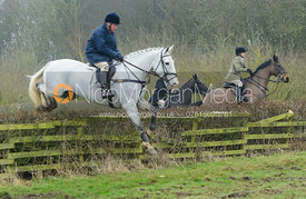 Charlie Gordon-Watson jumping a hedge at Town Park Farm