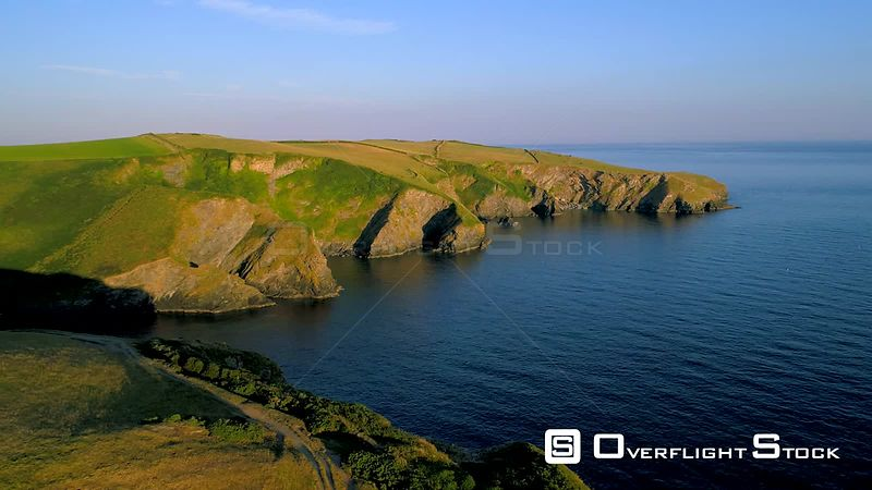 Static aerial clip of stunning headland and cliffs near Port Isaac in Cornwall during the golden hour
