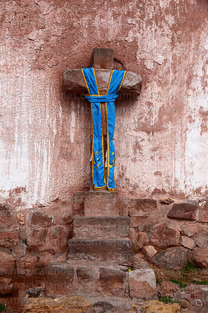 Decorated stone cross outside colonial church, Maras, Cusco Region, Peru