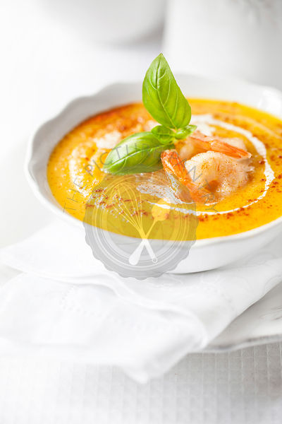 Pumpkin soup with shrimps and basil