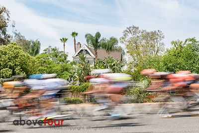 The men's peloton streak past one of Highland's many historic houses during Stage 3 of the Redlands Bicycle Classic.
