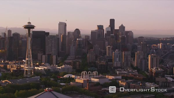 Seattle, Washington Aerial view of Seattle at sunrise with Space Needle and Mt. Rainier.  Shot with Cineflex and RED EpicW Helium.