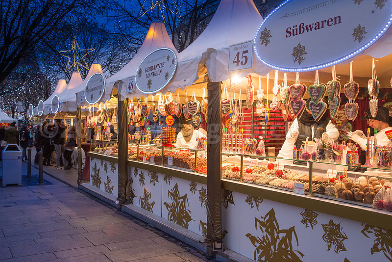 Long Line of White Pointed marquees tempt shoppers in at the White Magic Christmas Market