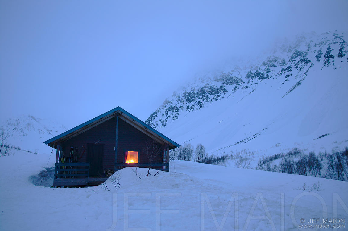 Wilderness hut by winter night