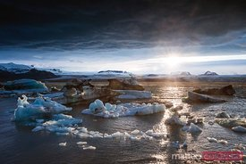 Dramatic midnight sun at Jokulsarlon glacial lake, Iceland