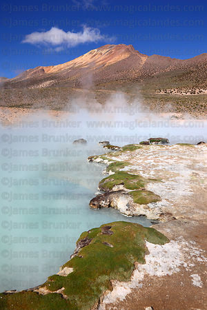 Hot springs at Polloquere and Cerro Capitan peak , Salar de Surire , Region XV , Chile