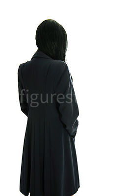 A semi-silhouette of a 1940's mystery woman in a coat – shot from eye-level.