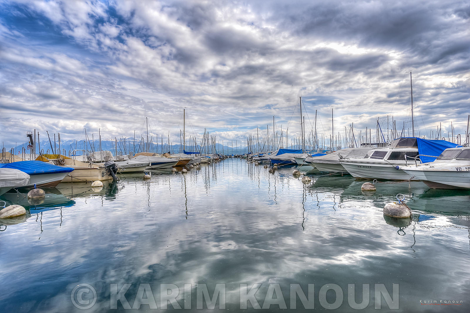 Daramatic sky reflection with boats in the middle - Vidy, Lausanne