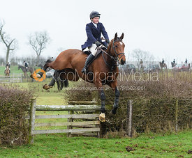 Meghan Healy Jumping a fence at Lambing's. The visit of the Wynnstay Hounds to the Cottesmore 27/11