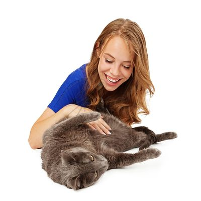 Smiling Girl Playing With Cat