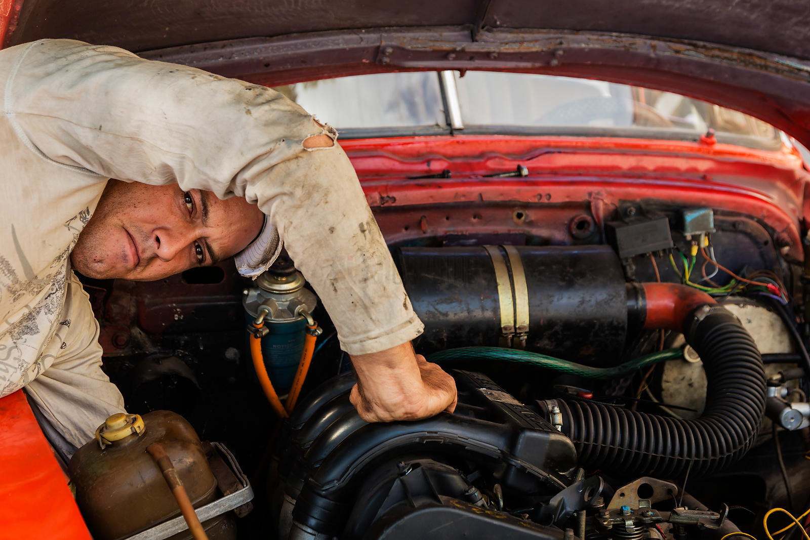 Mechanic Working on Vintage American Car