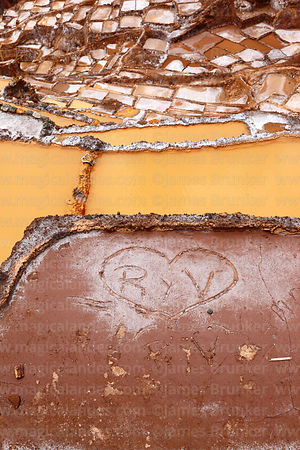 Love heart drawn in mud in salt evaporation pond at Las Salineras, Maras, near Cusco, Peru