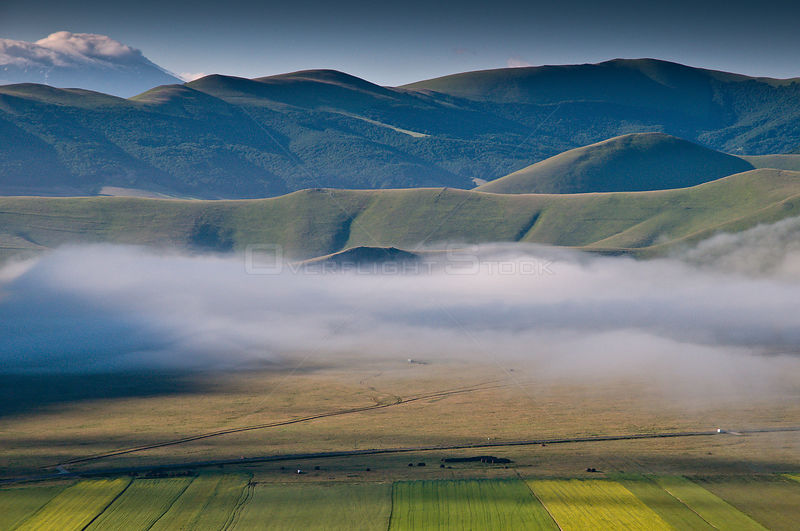 Low lying cloud / mist over the Piano Grande in the early morning, Sibillini, Norcia, Italy, June 2010