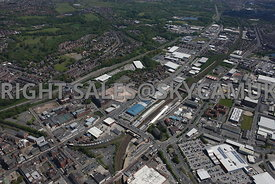 Bolton high level aerial photograph of Trinity Retail Park and the development site of old factories on Manchester Road and Grosvenor Street and Gorton Street and the Central Retail Park and Bolton Railway Station
