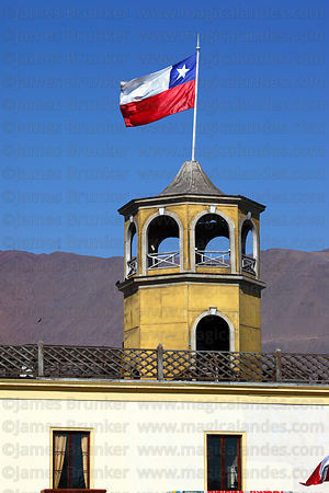 Chilean flag on tower of old customs building , Iquique , Region I , Chile