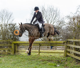 Julia Hallam Seagrave jumping a hunt jump - The Cottesmore Hunt at Grange Farm