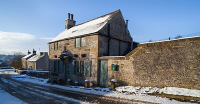 Snow on cottages in Hartington